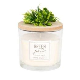 Duftkerze im Glas mit künstlichen Pflanzen